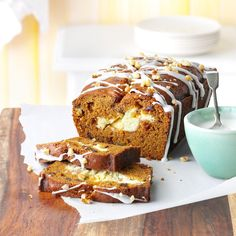 Pumpkin Swirl Bread Recipe -This combination of pumpkin, nuts and dates makes a delicious, golden bread. The surprise inside—a rich creamy swirl—is like a luscious layer of cheesecake in each slice. —Cindy May, Troy, Michigan