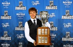 Artemi Panarin takes a photo with the Calder Memorial Trophy at the 2016 NHL Awards. #Blackhawks