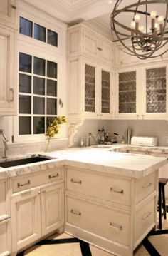 If my kitchen *had* to be white, I would want it to look like this. With that light fixture.