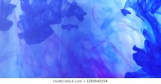Ink spill in water. Vibrant blue and purple ink drops spreading out in some water makes for an interesting background. Purple, Blue, Photo Editing, Royalty Free Stock Photos, Cocktails, Vibrant, Ink, Creative, Water