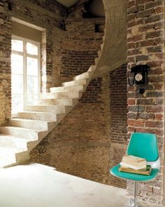 staircase made of raw concrete with exposed brick