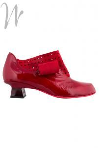 """#Red patent #leather upper with #suede detail which has punched #holes. Leather lined and removable insoles. Curled suede detail. 1"""" heel in red, and red rubber sole. Heavenly!"""