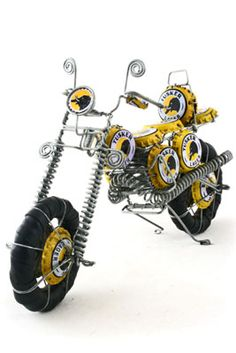 Recycled Bottle Cap Motorcycle, handcrafted in Kenya, available at Alternatives Global Marketplace. Here's a piece of recycled art with serious attitude. Crafted from wire and recycled Tusker beer bottle caps, our motorcycles are a great gift for roughnecks and folk art enthusiasts alike.