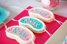 How sweet are these little sleep mask cookies for a spa party! #birthday #party #cookie