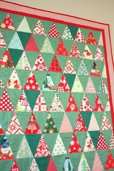 Behold: the Kitschy Christmas quilt. The inspiration for this quilt first came from this Anthropologie Quilt. I'd been thinking about it for a few weeks when I decided (on Thanksgiving Day) to make a Christmas version using all my scraps left over from last year's Retro Christmas Quilt. (I used my Accuquilt GO cutter Isosceles Triangle die to cut out this whole quilt in a very short amount of time.) I've been collecting those retro-vintagey fabrics and now my stash is seriously depleted…