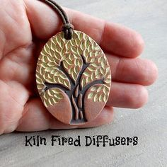 "251 Likes, 14 Comments - Yvi B. Jones (@kilnfireddiffusers) on Instagram: ""One of my favorite tree designs from my essential oil necklace diffuser inventory. This is a giant…"""