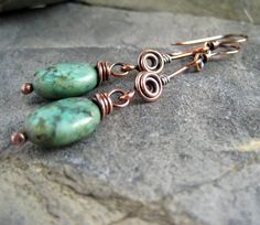 cool wirework - how do you do that swirl in the middle of wire...turquoise and copper, Cinnamon Jewellery