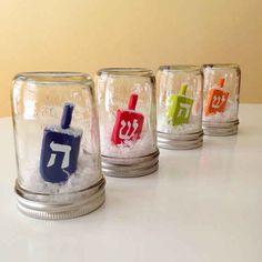 Create dreidel snow globes. | 21 Super Cute Ways To Decorate For Hanukkah