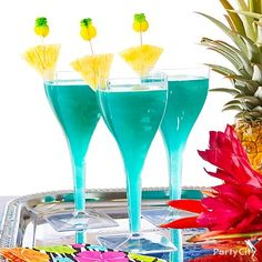 Pool Party Drink - Mix 1oz light rum, 2oz pineapple juice, 1oz Blue Curacao liquor and 1oz coconut cream, and serve your creations in clear goblets to let their cerulean blue color shine. Garnish with pineapple slices and Tropical Fruit Picks for a fun island touch.