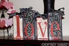 Wood blocks, spray paint, scrapbook paper and modge podge...oh, and ribbon!