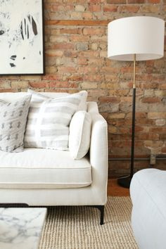 Neutral sofa + throw pillows: http://www.stylemepretty.com/living/2016/06/07/why-decorating-with-neutrals-will-never-ever-go-out-of-style/ | Photography : Danielle Moss - http://danielle-moss.com/