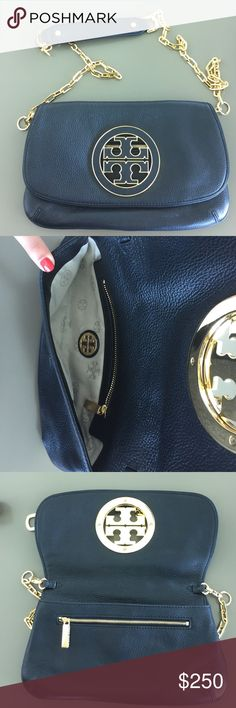 Black Tory Burch Clutch 100% authentic Tory Burch Clutch. Purse is in great condition. It has a removable gold chain strap and had gold hardware. Has slight scratches on the gold hardware and one small scratch on the leather. Dust bag not included. Used twice. Tory Burch Bags Clutches & Wristlets