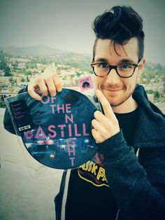 Dan Smith pointing at a pink sticker to disguise the fact he wants you to buy his music Submit Dan points here