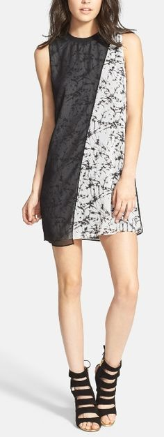 This jazzy sleeveless dress would be great for day or night!