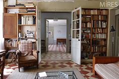 Cement tiles, books and doors in a French artist's house