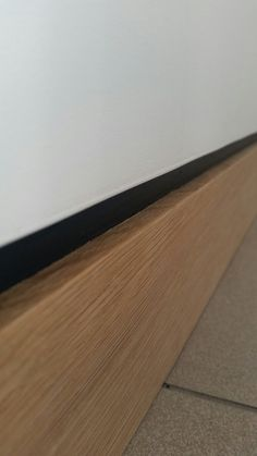 Oak skirting with dark grey shadow gap