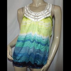 """Heartsoul Tunic top green blue semi sheer Pullover. Bust measures 38"""" in stretched. Shoulder to hem is 27"""". 100% polyester. Embellished neckline.                                    BUNDLE AND GET 20% OFF YOUR ORDER - PRICES ARE NEGOTIABLE DEPENDING ON THE ITEM. COMMENT AND WE CAN WORK SOMETHING OUT.   CHECK OUT MY eBay STORE TO FIND MANY MORE GOOD DEALS!!  http://stores.ebay.com/Southern-Boutique-Clothing HeartSoul Tops Tunics"""