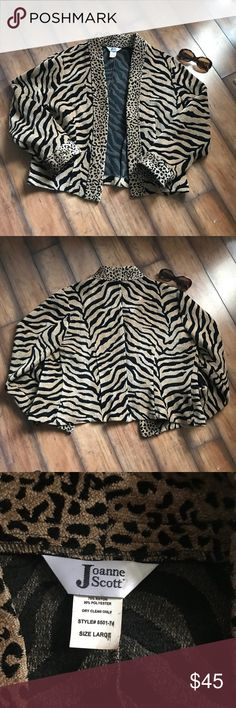 Animal Print Heavy Jacket Animal print jacket in pristine condition. Jacket is heavy and can be dressed up or down. Like new!! No blemishes at all! Joanne Scott Jackets & Coats Blazers