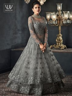 Silver Grey Zari Embellished Party Wear Lehenga Anarkali Suit is specifically designed to make you look perfect as a bride and bridesmaids. This suit set features zardosi and resham kari thread emb. Indian Gowns Dresses, Pakistani Dresses, Indian Wedding Gowns, Flapper Dresses, Net Dresses, Gown Wedding, Party Wear Lehenga, Party Wear Dresses, Party Gowns