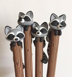 This curious raccoon has climbed up a pole to get a better look around your desk. Waiting for break time snacks, he can help you with writing a grocery list or maybe a lunch order. He is a well behaved raccoon for the most part and wont run around making a mess!    *This pen is decorated