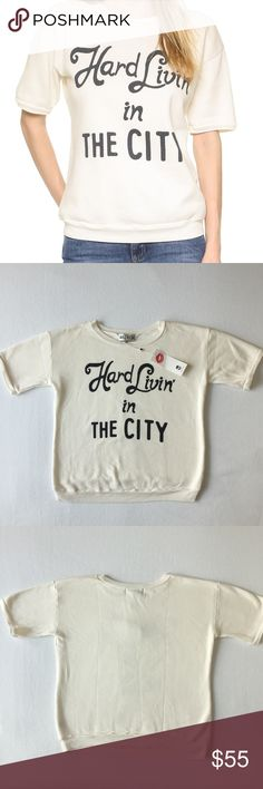 """WILDFOX Hard Livin' In The City 🌷Please Read the description! Thanks!🌷  Brand new with tag Size: L Retail : $95 Measurements: arm pit to arm pit 22"""", length 24""""  Color: Pearl White Color may be slightly different bcz of lighting  🌷Price is FIRM unless bundled 🌷NO Trades         🌷NO Holds 🌷All sales are final Welcome product-related questions! You are responsible for your size. Wildfox Tops"""