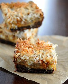 Pumpkin Magic Bars - EASY autumn dessert with pumpkin, white chocolate, butterscotch, walnuts and coconut in a gingersnap crust.