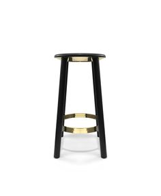 The beautiful Baker stool from IMO in black powder coated aluminium, which has been classically paired with brass elements.