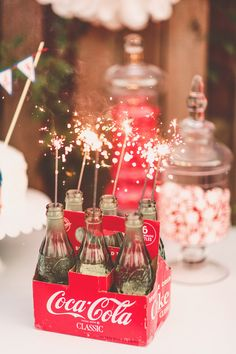 sparklers-in-coke-bottles for a Coca-Cola Party Dessert Bar Wedding, Wedding Desserts, Dessert Table, 4th Of July Party, Fourth Of July, Coca Cola Party, Share A Coke, Coca Cola Bottles, American Wedding