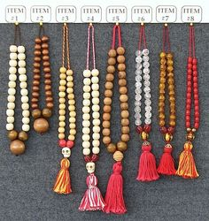 Rosary, 'Museum of London' (1400) This group patterned after a string of 27 round, wooden rosary beads in the collection of the Museum of London. (MoL accession number 5079, found at Worship Street, Finsbury in 1890).: