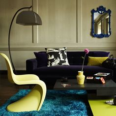 Bold and bright living room | housetohome.co.uk - love the blue mirror