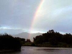 Rainbows on the river last evening ---Just to think the good Old pot 'O gold is just out of reach right over there ---I was so close but yet so far 7/20/14 ----pL