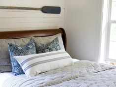 RMS user and HGTV contributor Layla Palmer has a wonderful way with color. In this beach-inspired bedroom she exposed the white wooden planks behind the bed for a rustic look an ideal backdrop for an oar-turned-art piece. Ocean Bedroom, Nautical Bedroom, Coastal Bedrooms, White Bedroom, Coastal Bedding, Nautical Theme, Cabin Bedrooms, Coastal Curtains, Rustic Bedrooms