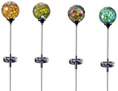 """Gift Craft 32.9-Inch Mosaic Glass and Metal Solar Garden Stakes, Large by Gift Craft. $89.39. Vibrant mosaic glass finishes. Outdoor safe. Lights up to create a beautiful outdoor ambiance. Add a soft glow of light and a whole lot of beauty to your garden with the set of four solar lighted mosaic glass garden stakes. requires 1-aa battery, not included. measures approximately 5.1"""" x 3.9"""" x 32.9""""."""