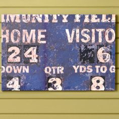 Love this scoreboard wall decor idea for a boys sports themed bedroom! Discover more kids room decorating and organizing tips and ideas @ http://kidsroomdecorating.net