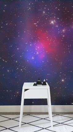 The image, taken and studied by scientists at NASA, shows that the galaxies in this cluster make up only about 5% of it's mass. The beautiful nature of the coloured elements make this a striking wallpaper in bright pink and purple, with fantastic detail of the galaxies visible up close.#wallpaper #murals #wallmurals #interior #design #home #homedecor #decor #accentwall #inspiration #ultraviolet