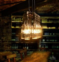 Wine Bottle Suspension Lamp.  This etsy shop makes all kinds of amazing light fixtures with wine bottles, beer bottles and cans, oil filter cans, even a fry basket!  Amazing creativity!!
