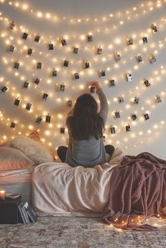 Hang pictures on the string lights to create an enchanting photo wall.