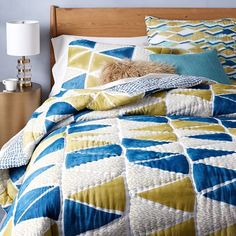 Hand-blocked triangle quilt and shams in crystal blue from West Elm http://www.westelm.com/products/hand-blocked-triangle-quilt-shams-crystal-blue-b1859/?pkey=cbedding-collections graphic-triangle-collection 