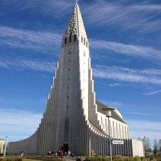 Here is Iceland's Hallgrimskirkja. Look close at the clouds--the steeple seems to have scratched the sky. #iceland #reykjavik #travel