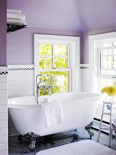 Purple general bathroom. Claw foot tub. Great big vanity. Double Shower behind tiled wall ( no glass to clean)   Lots of towel rails and space for chair And clothes hampers