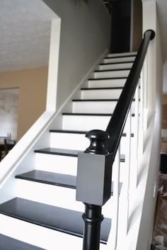 Beautiful Painted Staircase Ideas for Your Home Design Inspiration. see more ideas: staircase light, painted staircase ideas, lighting stairways ideas, led loght for stairways. Black And White Stairs, Black Staircase, Black Railing, Open Staircase, Staircase Design, Staircase Ideas, Black Painted Stairs, Black Wood, Railing Ideas