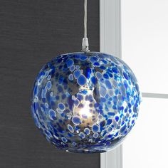 Speckled Hand Blown Glass Pendant Specked with color, each pendant is made from hand-blown glass and finished with chrome accents. Due to the nature of the hand-blown glass each pendant will vary slightly in size and color. Hang several colors together for a jazzy look or keep it simple with one color. Choose from Yellow, Orange, Light Blue or Cobalt Blue