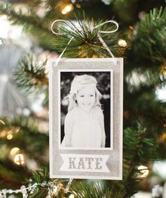 8 Adorable DIY Ornaments for Displaying Your Family Photos | If your pictures are piling up in cardboard boxes, use these crafts as an excuse to finally get organized and trim the tree.