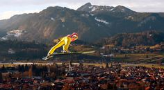 German Richard Freitag soars through the air during practice for the 62nd four-hills ski jumping tournament in Oberstdorf, Germany. (REUTERS/Michael Dalder)