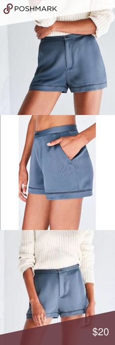 """Silence + Noise Breanne Satin Short Upgrade your shorts game with this high-rise sateen pair from UO brand Silence + Noise. Slim fit with banded waist + lattice lace insert trim. Button zipper closure at front. Material: 100% Polyester; Measurements: Waist 29.5"""", Rise 11"""", Inseam 2.5"""", Leg opening 12.5"""" Urban Outfitters Shorts"""