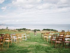 What an amazing view to walk down the aisle towards......birdcagesanddragonflies@gmail.com our folding chairs look lovely....