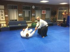This is Chris McGrath and Colin Jardine in the Tuesday 8-9pm class at Martin Acton's Aikido Institute in Dromore BT251AA. They are practicing putting an assailant down when he attempts to punch you in the stomach.