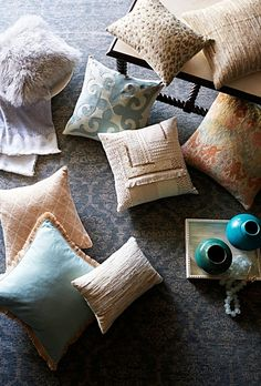 Blends of texture and color create intrigue in any setting. Click to shop pillows in all shapes, sizes, color and texture.