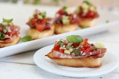 Bruschetta (Italian pronunciation: bru-sket-ta) is a small dish of toasted or grilled rustic bread rubbed with garlic and topped with extra virgin olive oil. We serve tomato's bruschetta (with cherry tomatoes) as antipasto or appetizer or snack. Bruschetta Recept, Tomato Bruschetta, Homemade Bruschetta, Italian Appetizers, Yummy Appetizers, Appetizer Ideas, Baby Shower Appetizers, Wedding Appetizers, Halloween Recipe