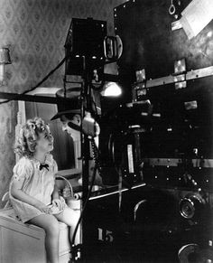 Director Harry Lachman works some magic with Shirley Temple for Baby Take a Bow - 1934